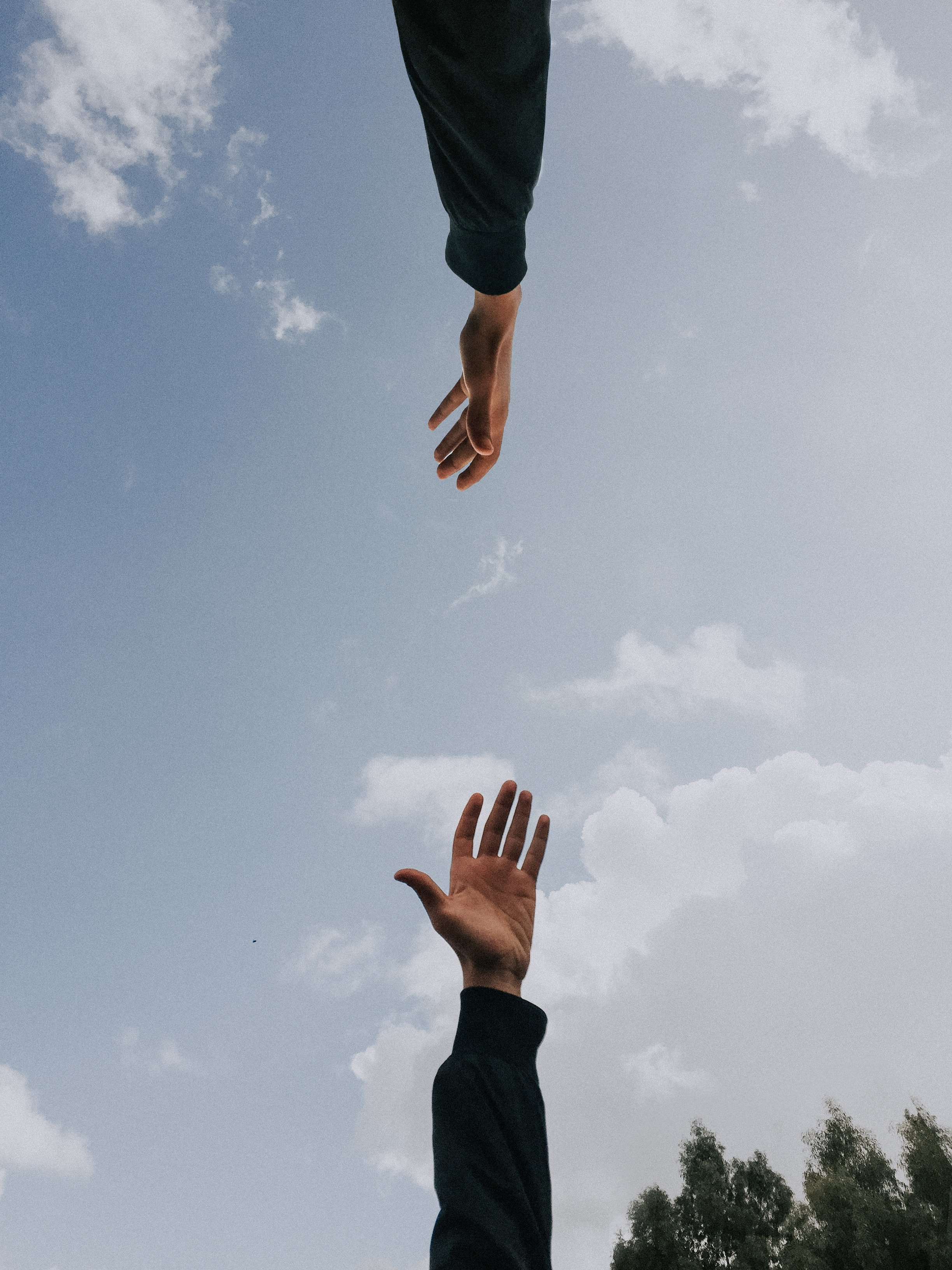Two hands letting go | Source: Unsplash.com