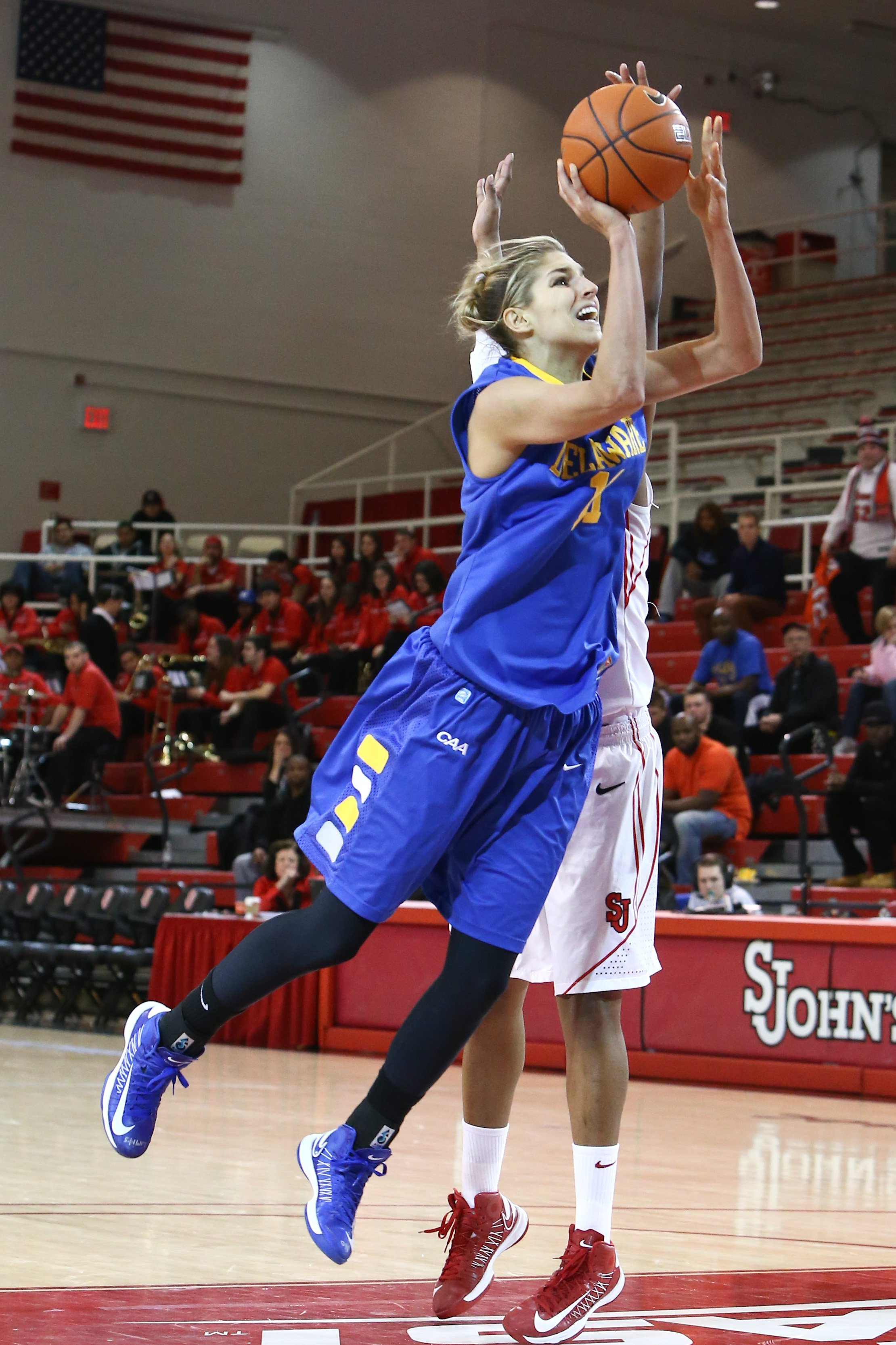 Elena Delle Donne (11) goes up for a shot against the St. John's Red Storm at Carnesecca Arena on January 2, 2013 in Jamaica, Queens, New York | Photo: Shutterstock