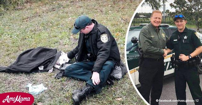 Ein Polizist bleibt stehen, um einen Hund zu trösten, der fast von einem Auto überfahren wurde, und gibt ihm seine Jacke