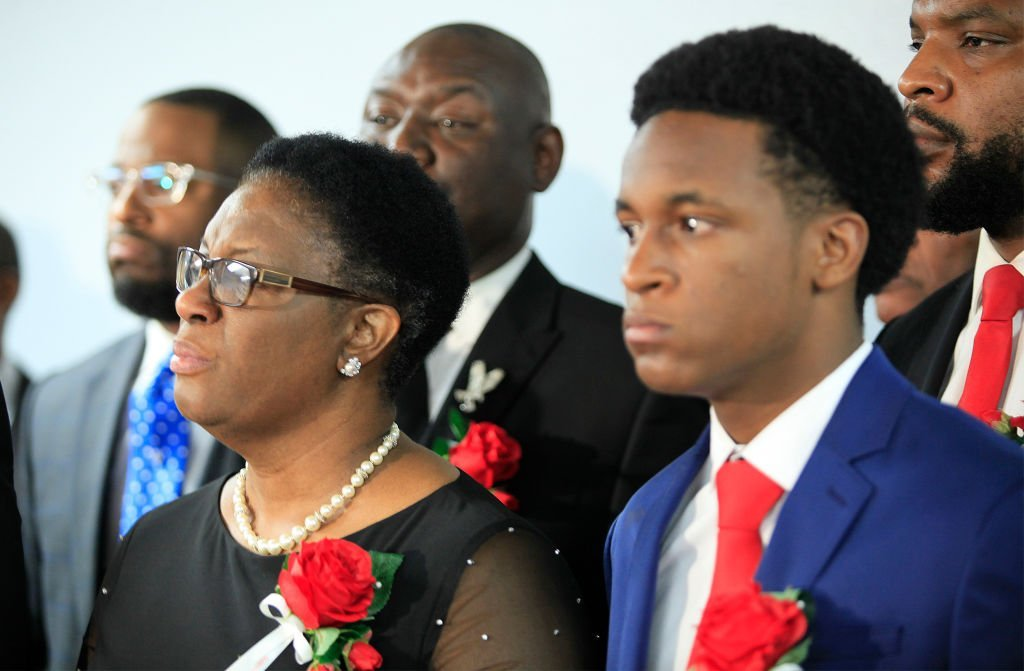 Allison Jean, mother of Botham Shem Jean, stands with family and church members of Greenville Avenue Church of Christ after the funeral service | Photo: Getty Images