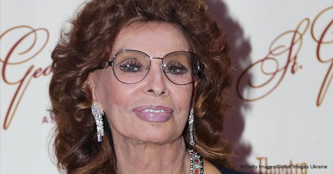 Sophia Loren Turns Heads in an Embellished Ivory Gown Which Features a Plunging Neckline