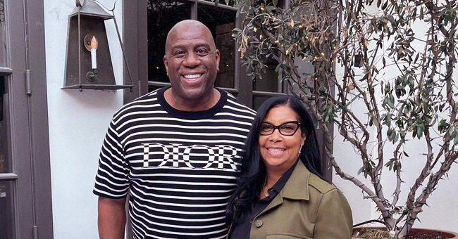 Cookie Johnson Dons a Khaki Coat & Tight Navy Pants on a Romantic Date Night with Husband Magic