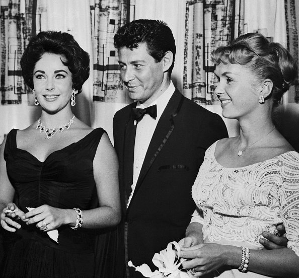 Eddie Fisher, Debbie Reynolds, and Elizabeth Taylor at the Tropicana Hotel, undated picture. | Photo: Getty Images