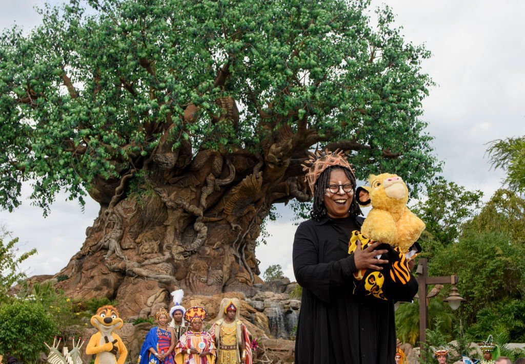 """Whoopi Goldberg and the cast of the musical show """"Festival of the Lion King"""" work on ABC's """"The View"""" broadcasting from Disneys Animal Kingdom in Lake Buena Vista, Florida 
