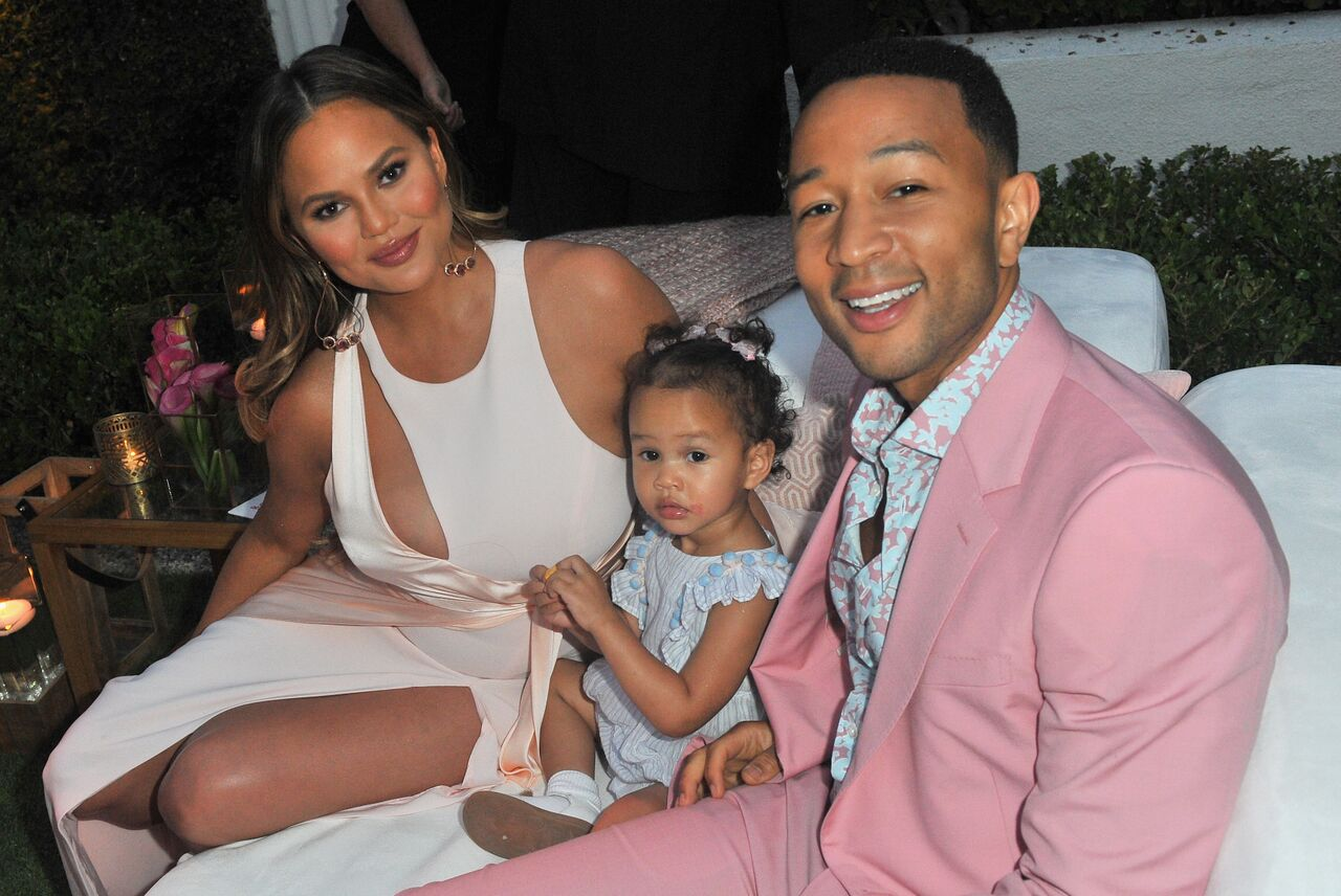 Chrissy Teigen, Luna Simone Stephens and John Legend attend John Legend's launch of his new rose wine brand. | Source: Getty Images