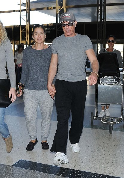 Jean-Claude Van Damme and Gladys Portugues are seen at LAX on January 31, 2015 | Photo: Getty Images