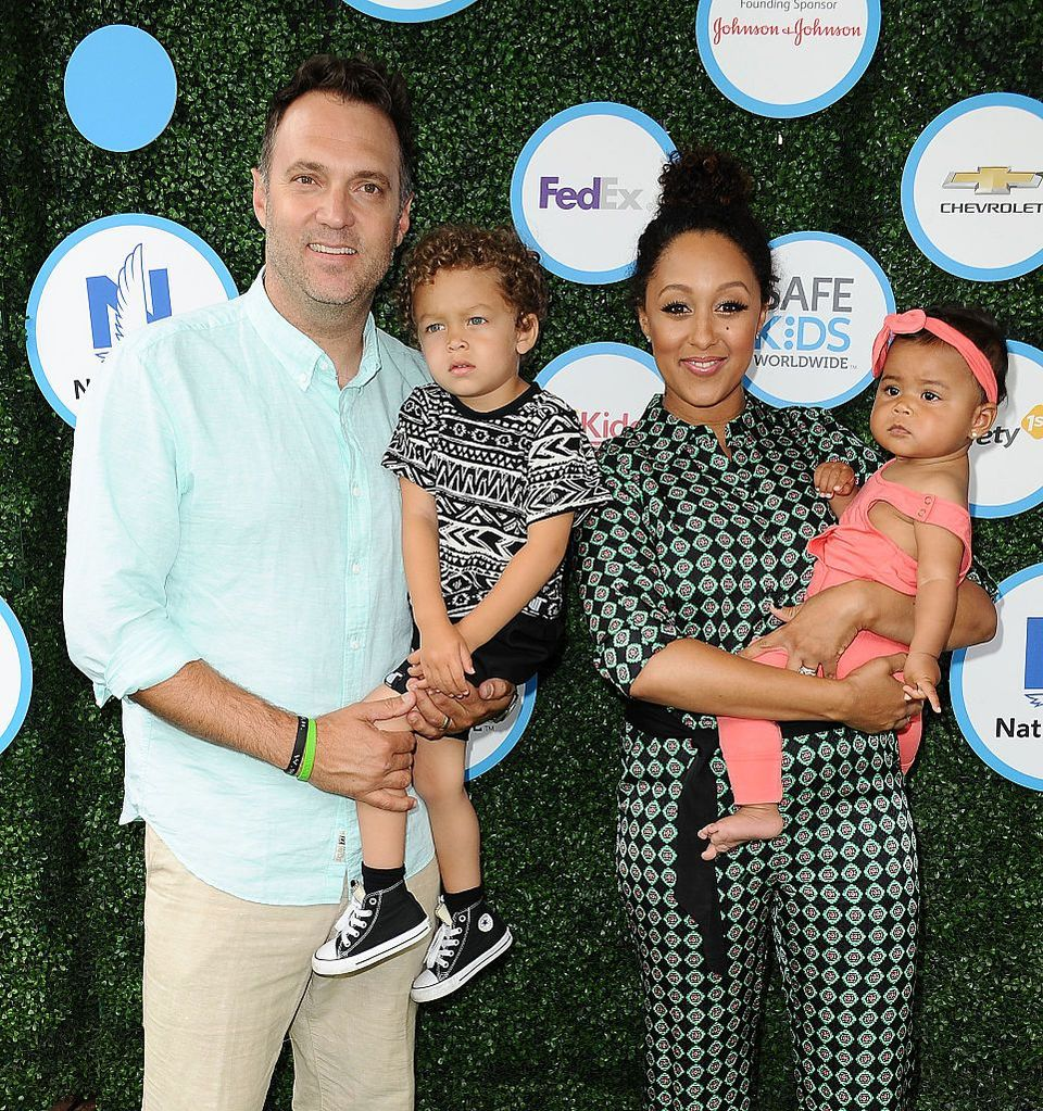 Adam Housley, Tamera Mowry and their kids Aden and Ariah at the Safe Kids Day event at Smashbox Studios on April 24, 2016 in Culver City, California. | Source: Getty Images