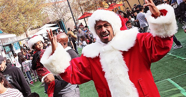 Nick Cannon Dresses up as Santa and Participates in Charity Event Amid Ongoing Feud with Eminem