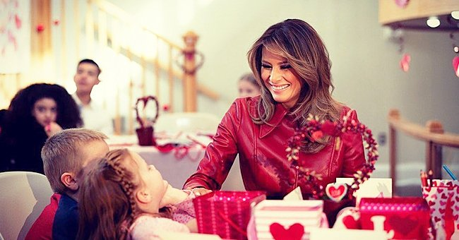 Melania Trump Stood out in Ruby Red Faux Leather Coat as She Visited a Children's Hospital on Valentine's Day
