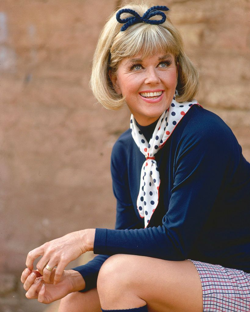 Doris Day, US actress and singer, wearing a red, white and blue polka dot neckscarf and a dark blue jumper, with a dark blue bow in her hair, circa 1965 | Source: Getty Images
