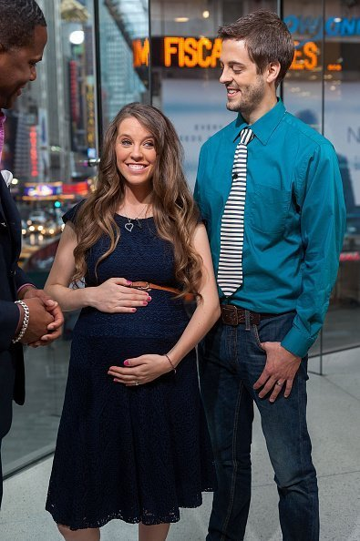 """Jill Duggar Dillard (L) and husband Derick Dillard visit """"Extra"""" at their New York studios at H&M in Times Square on October 23, 2014 