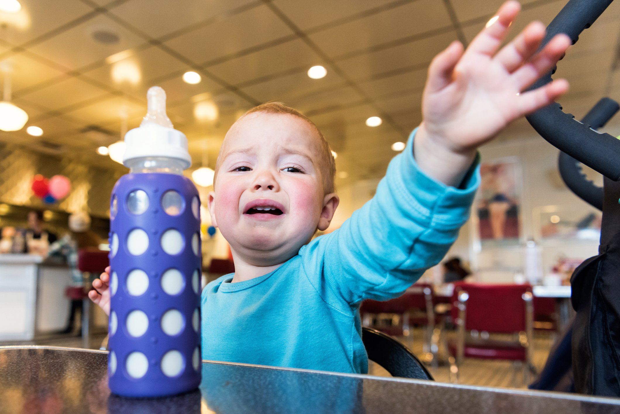 Baby boy cries uncontrollably in a restaurant | Photo: Getty Images