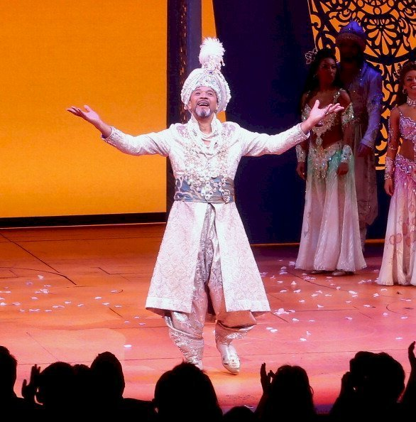 "Clifton Davis takes a bow during curtain call at the the ""Aladdin"" On Broadway Opening Night at New Amsterdam Theatre 