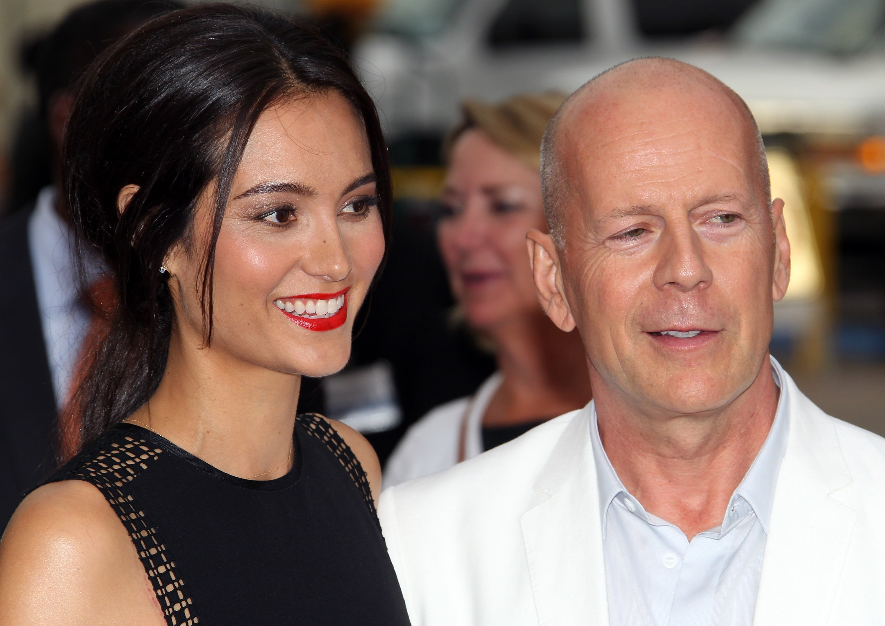 """Emma Heming Willis (L) and husband actor Bruce Willis attend the premiere of Summit Entertainment's """"RED 2"""" at Westwood Village on July 11, 2013, in Los Angeles, California. 