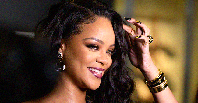 Rihanna Appears to Shut down Pregnancy Rumors by Showing off Flat Tummy in a Leopard-Print Dress at Visual Autobiography Launch