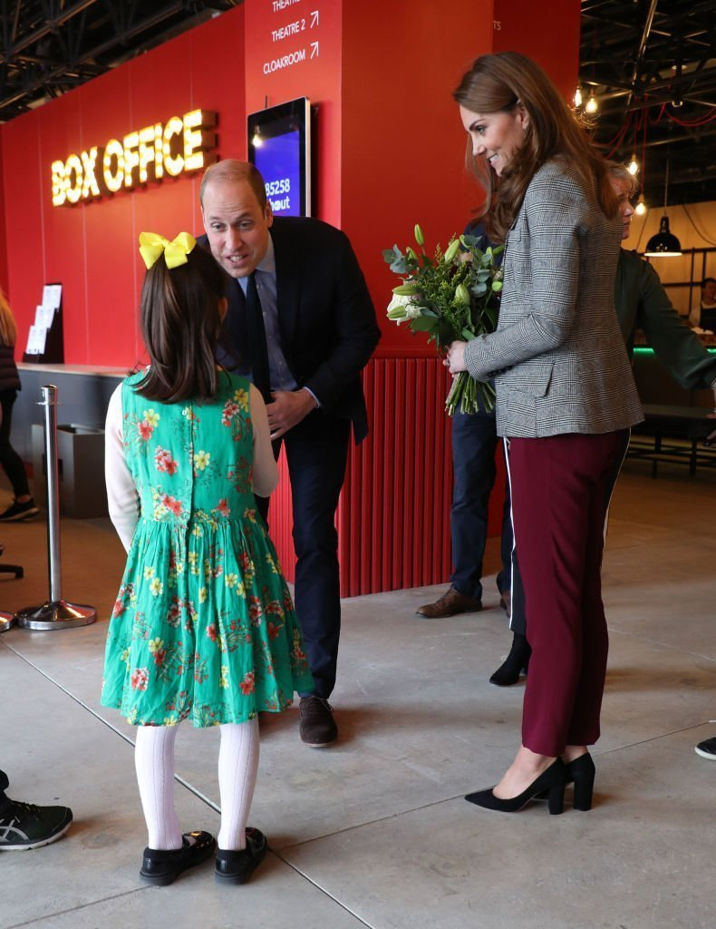 Prince William, Duke of Cambridge and Catherine, Duchess of Cambridge meet Michaela Conway, aged eight from Eltham as they attend Shout's Crisis Volunteer celebration event at Troubadour White City Theatre | Photo: Getty Images