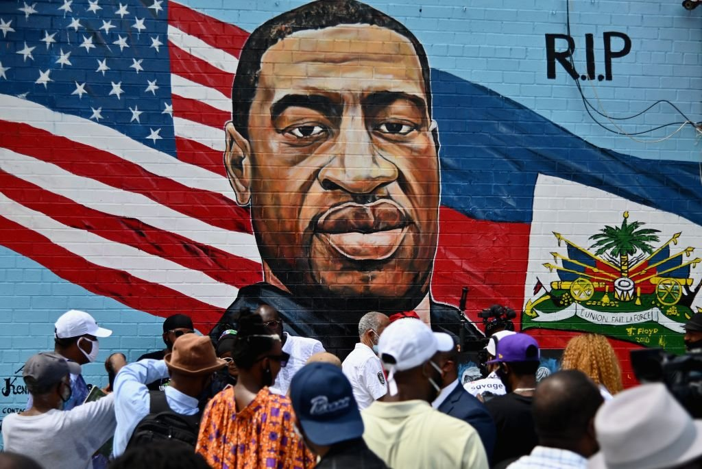 A memorial portrait of George Floyd painted on a storefront sidewall of CTown Supermarket on July 13, 2020 in Brooklyn, New York. | Photo: Getty Images