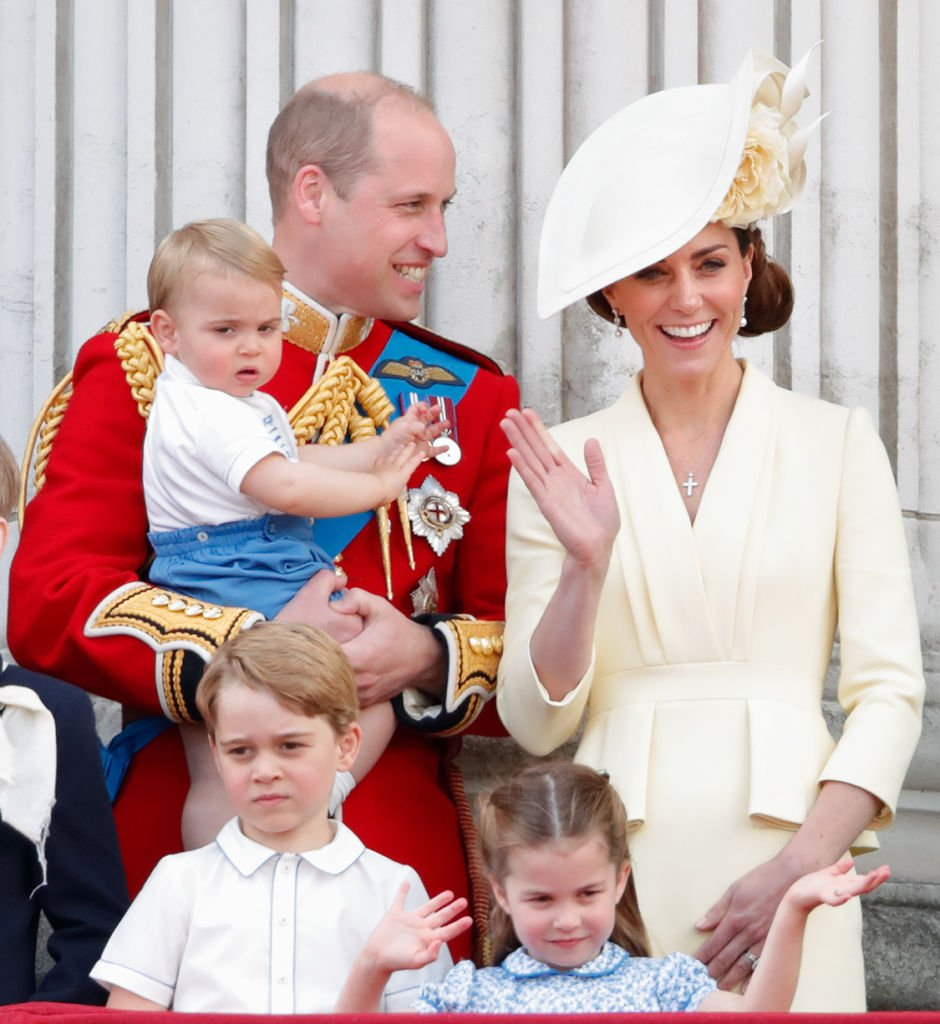 Prince William, Duke of Cambridge, Catherine, Duchess of Cambridge, Prince Louis of Cambridge, Prince George of Cambridge and Princess Charlotte of Cambridge stand on the balcony of Buckingham Palace during Trooping The Colour. | Photo: Getty Images
