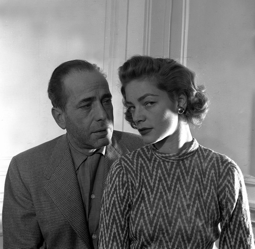 Portrait of American film actor Humphrey Bogart with his actress wife Lauren Bacall at the Savoy in London, 1951. | Source: Getty Images
