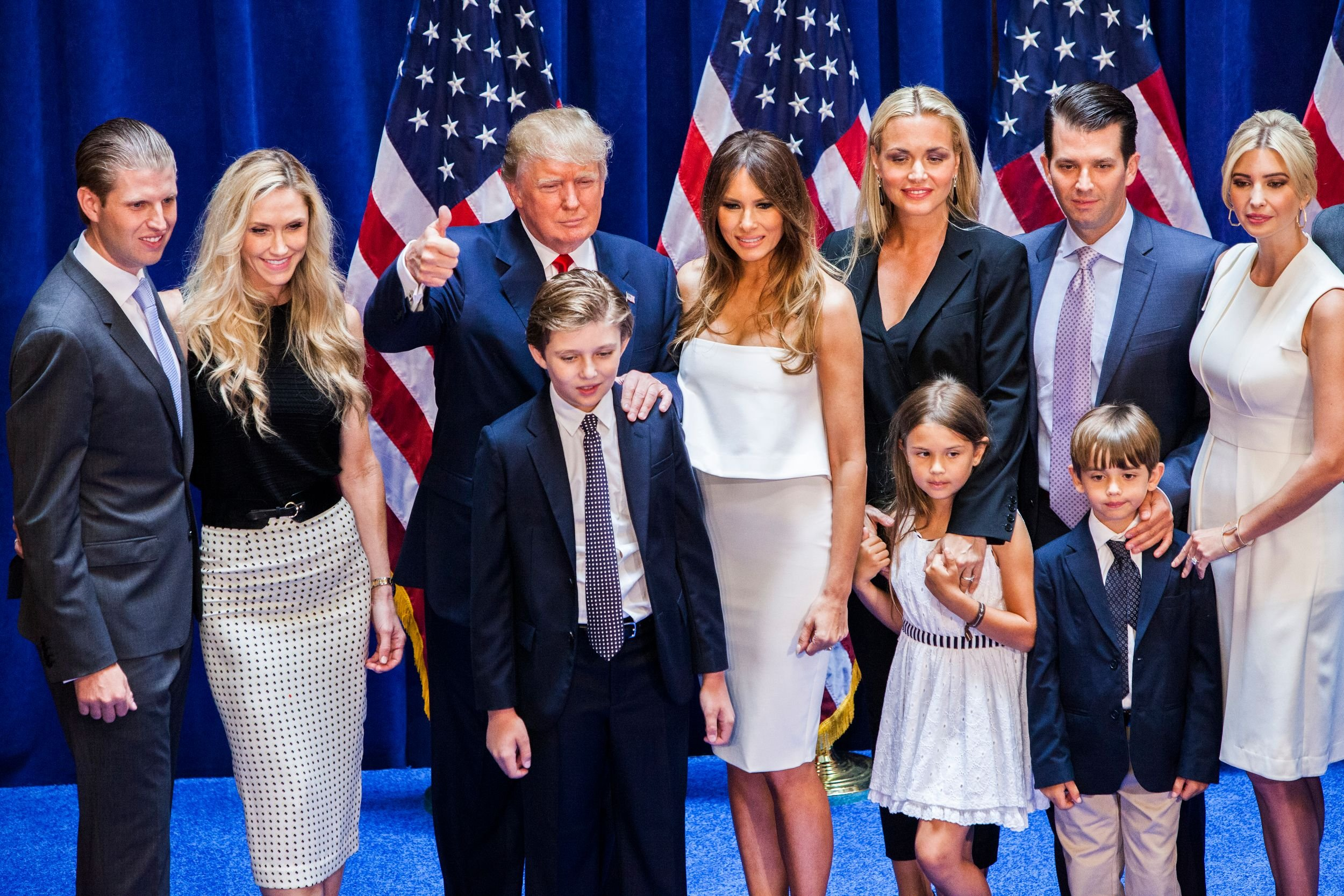 Eric Trump, Lara Yunaska Trump, Donald Trump, Barron Trump, Melania Trump, Vanessa Haydon Trump, Kai Madison Trump, Donald Trump Jr., Donald John Trump III, and Ivanka Trump pose for photos on stage after Donald Trump announced his candidacy for the U.S. presidency at Trump Tower 2015| Photo: Getty Images