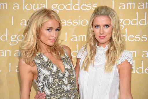 Paris Hilton and Nicky Hilton Rothschild pictured at the Alice + Olivia By Stacey Bendet Spring 2016 show during New York Fashion Week. | Photo: Getty Images
