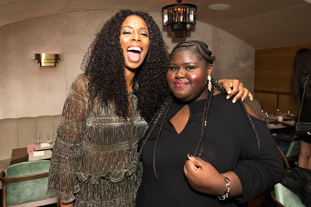 Tasha Smith and Gabourey Sidibe attend Lee Daniels Cover Launch with Louis XIII and Rolls-Royce, on December 7, 2016, in West Hollywood, California | Source: Rochelle Brodin/Getty Images for Haute Living