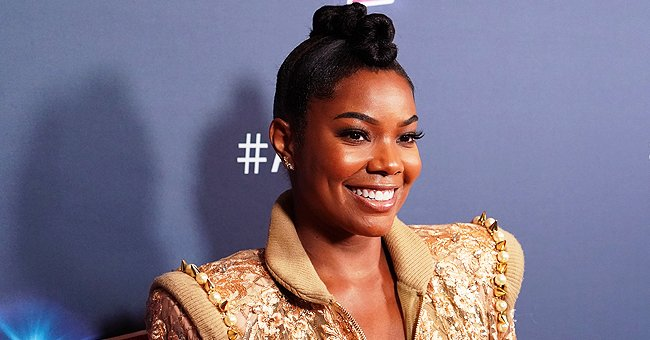 Gabrielle Union's Daughter Kaavia Changes Her Facial Expressions in Pics While Wearing a Pink Coat