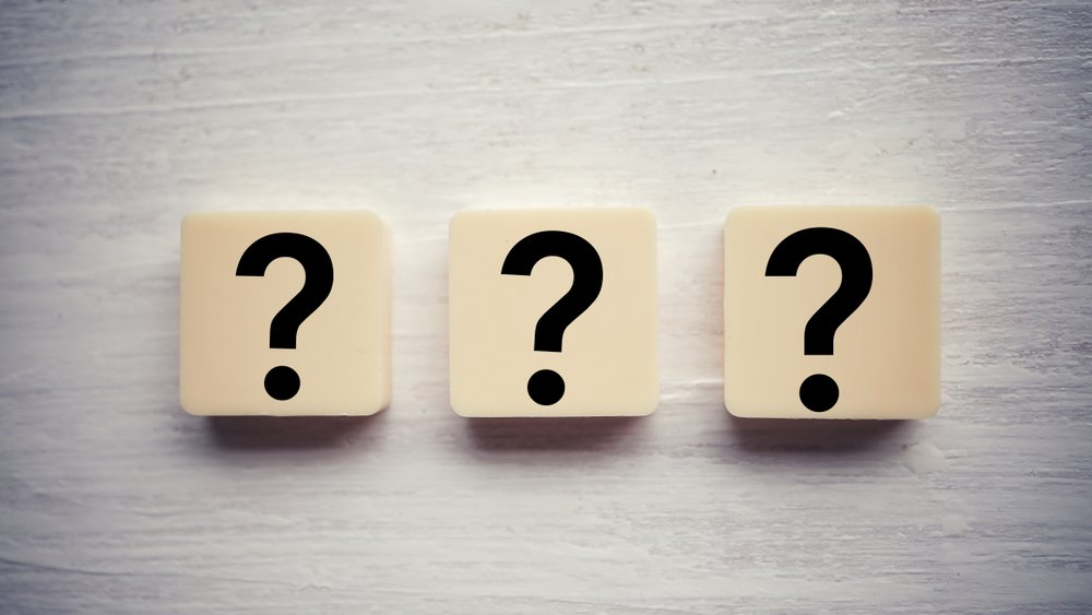 A photo that shows three question mark symbols | Photo: Shutterstock