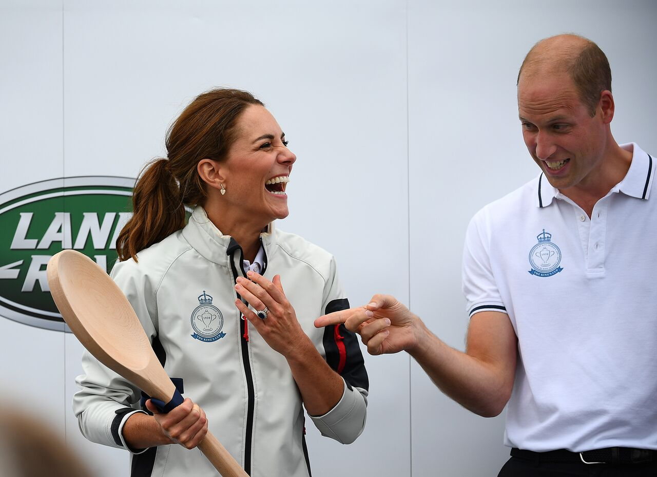 Kate Middleton accepts the giant wooden spoon at the prize-giving ceremony during the King's Cup charity race event. | Source: Getty Images