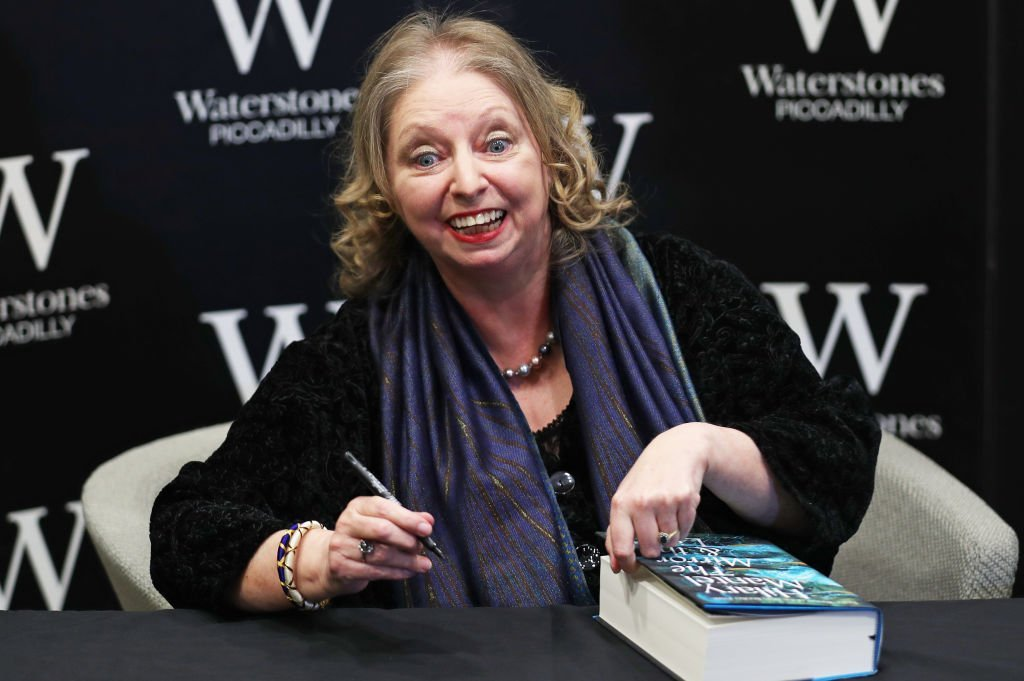 Hilary Mantel with her book 'The Mirror & The Light', the conclusion in her Cromwell sequence, during a preview event at Waterstones on March 04, 2020 | Photo: Getty Images