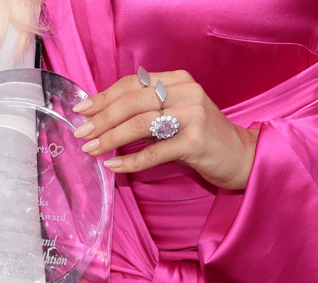A close-up of Lady Gaga's gorgeous pink sapphire engagement ring from the Children Mending Hearts' 10th Annual Empathy Rocks, 2018, California. | Photo: Getty Images