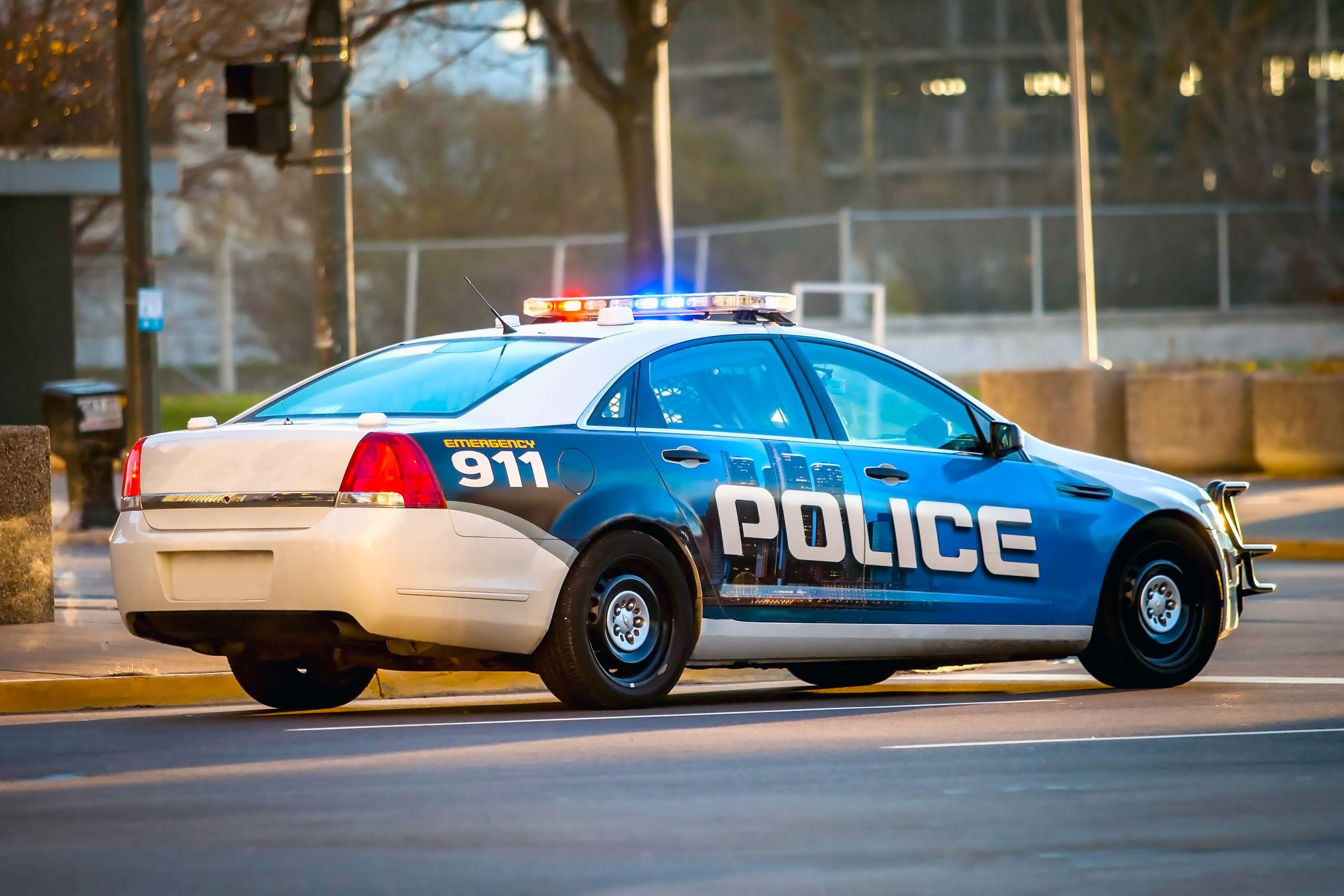 Police vehicle driving down a road. | Source: Shutterstock