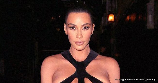 Kim Kardashian's breasts are on display in a racy black gown that left little to the imagination