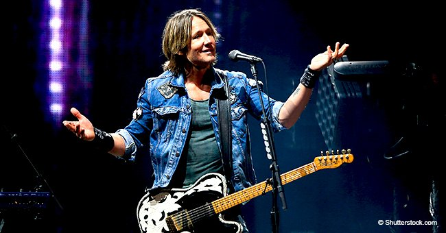 Keith Urban brings a shy girl on stage, but the moment they start singing, the crowd erupts