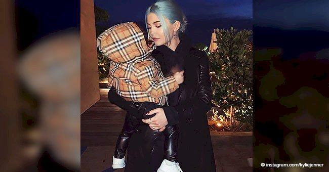Kylie Jenner cradles daughter Stormi who's rocking a luxurious $380 Burberry coat in precious photo