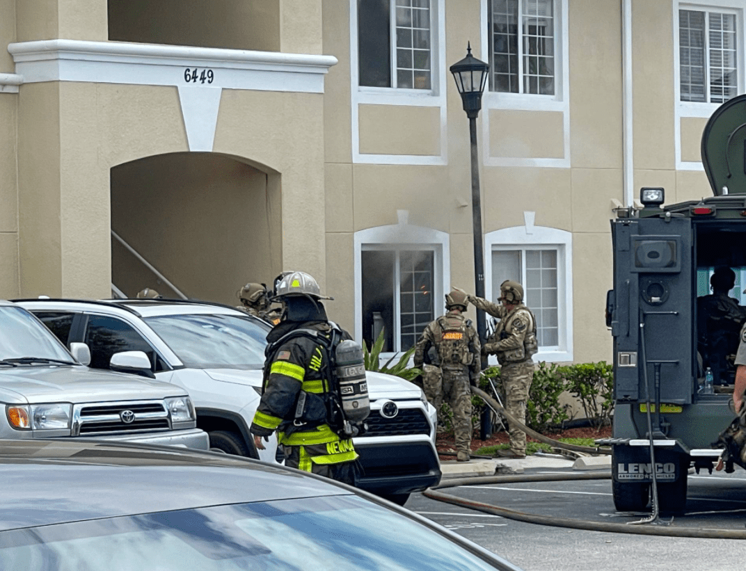 Pictured - Firefighters and the SWAT team outside the residence where the crime took place   Source: Facebook/ SheriffChadChronister