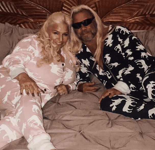 "Picture of Beth Chapman and her husband Duane ""Dog"" Chapman laying down together 