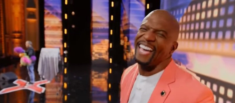 """Teri Crew, The host of """"America's Got Talent"""" laughing. 