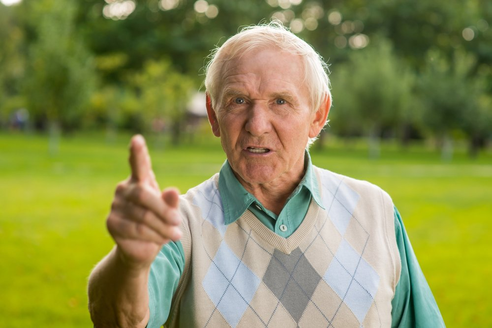 Angry grandfather threatens younger person. | Photo: Shutterstock.