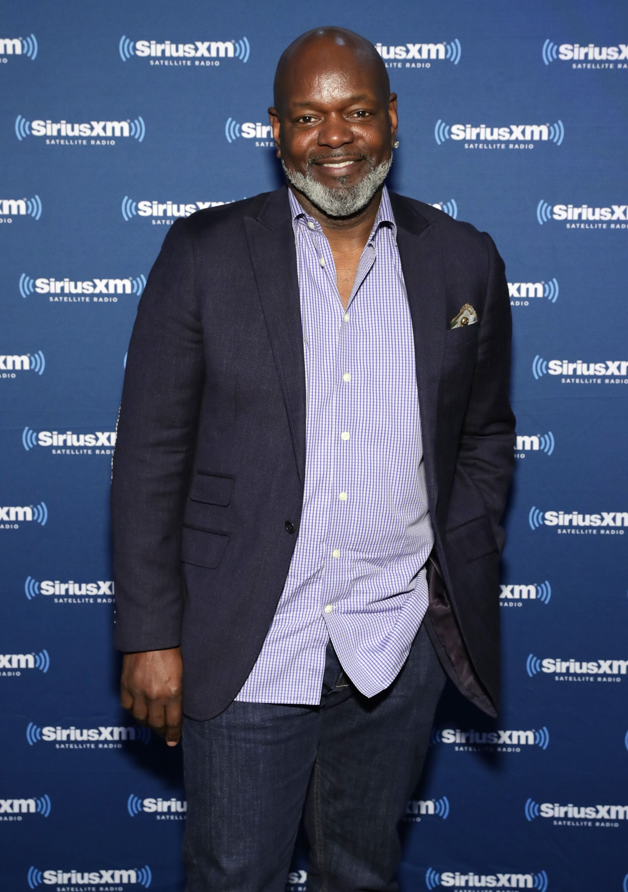 Former NFL player Emmitt Smith visits the SiriusXM set at Super Bowl 51 Radio Row at the George R. Brown Convention Center on February 2, 2017 | Photo: Getty Images