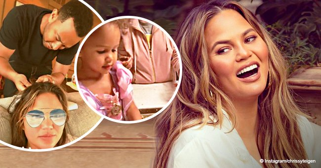 Chrissy Teigen had her hair done by hubby John Legend and dinner prepared by their daughter