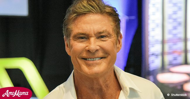 David Hasselhoff, 65, flaunts his muscular biceps as he goes shirtless while taking a stroll