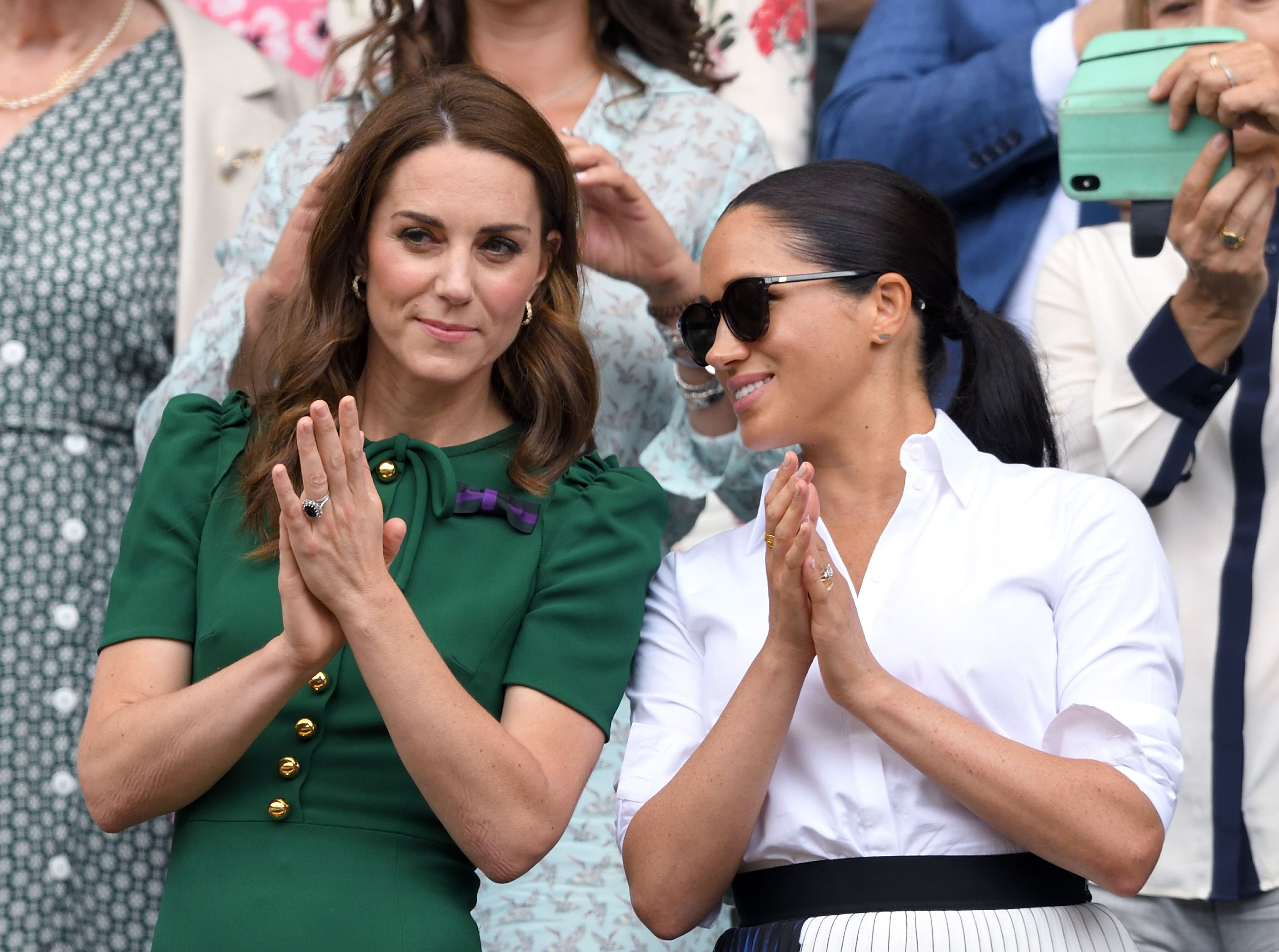 Kate Middleton and Meghan Markle in the Royal Box at day twelve of the Wimbledon Tennis Championships at All England Lawn Tennis and Croquet Club on July 13, 2019 | Photo: Getty Images