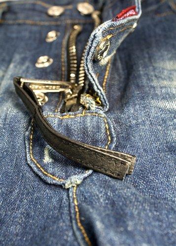 A closeup of a zipper with string detail. | Source: Shutterstock.