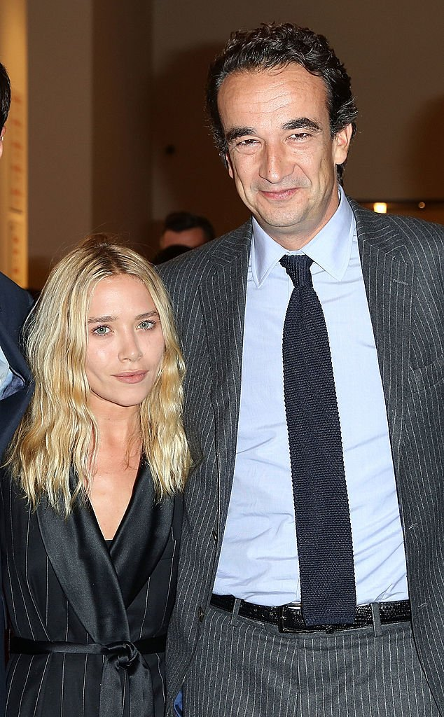 """Mary-Kate Olsen and Olivier Sarkozy attend the """"Take Home a Nude"""" Benefit Art Auction in New York City on October 8, 2013 