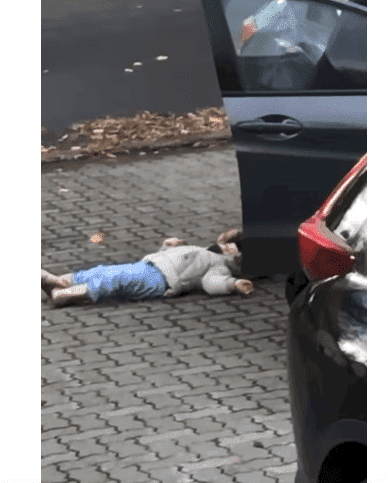 The girl pretending to be too exhausted to walk. Photo: YouTube/Viral Hog