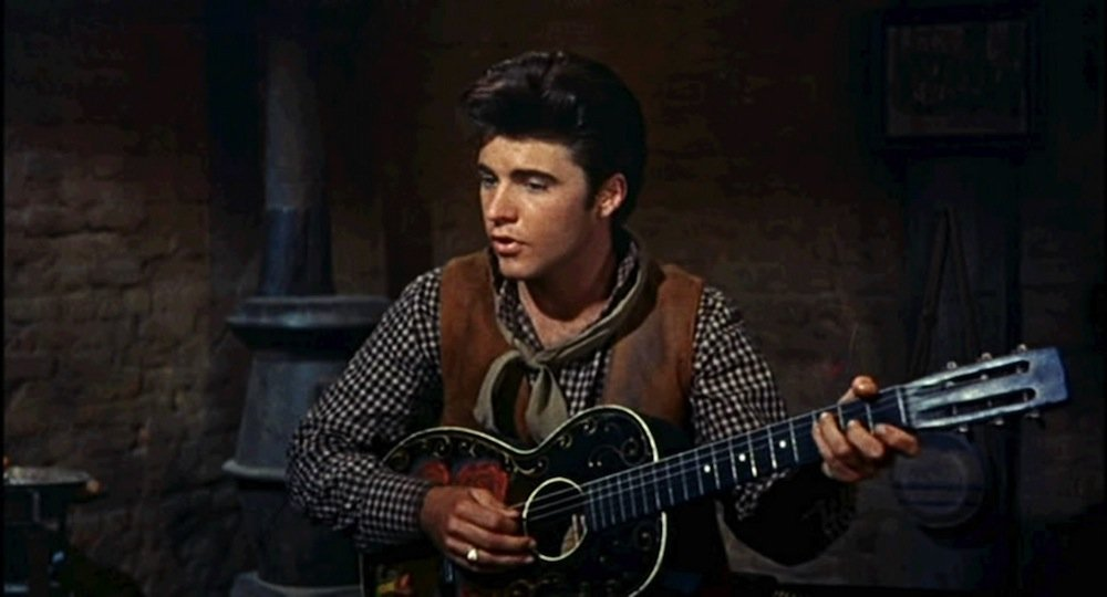 Cropped screenshot of Ricky Nelson from the trailer for the film Rio Bravo, 1959. | Photo: Wikimedia Commons Images