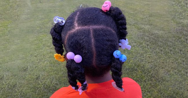 A six-year-old girl wore colorful hair clips to her soccer match and was not allowed to play because of it   Photo: Facebook/DiamondMx2