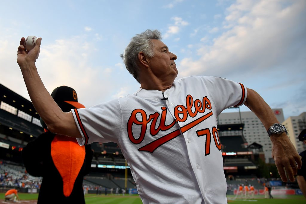 Barry Williams throws the first pitch at an Orioles game. Image Credit: Getty Images