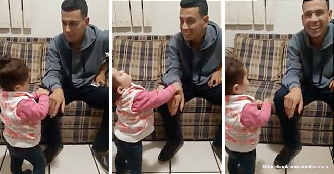 2-year-old girl warms hearts as she uses sign language to speak to her deaf father